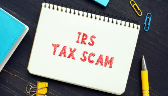 Business concept meaning IRS TAX SCAM with inscription on the piece of paper. IRSimpersonationscamsinvolvescammerstargeting American taxpayers by pretending to be IRS collection officers
